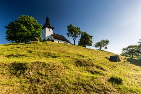 ruzomberok: View of a typical old slovak church in the village Martincek near Ruzomberok, Slovakia in summer 2015