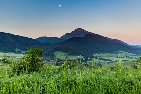 in low spirits: View of the mountain Choc at sunrise near Dolny Kubin, Slovakia in summer 2015