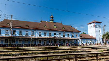 ruzomberok: RUZOMBEROK, SLOVAKIA - JUNE 4, 2015: Exterior view of the main railway station in Ruzomberok, Slovakia on June 4, 2015. It was opened on December 8, 1871.