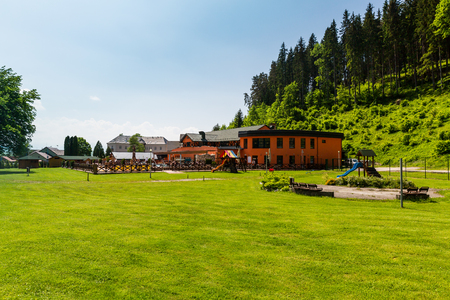 swimm: LUCKY, SLOVAKIA - JUNE 4, 2015: Views of the village, nature and leisure park of Lucky on June 4, 2015. Lucky is a small village in the Liptov region in Slovakia, well known for its thermal springs.