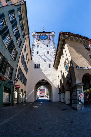 renewed: BADEN, AARGAU, SWITZERLAND - JUNE 30, 2015: Exterior views of the tower Stadtturm in Baden on June 30, 2015. Baden is a municipality in the Swiss canton of Aargau, located 25 km (16 mi) northwest of Zurich.