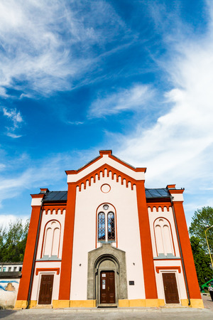 ruzomberok: RUZOMBEROK, SLOVAKIA - JUNE 3, 2015: View to the synagogue of Ruzomberok, a famous and historical buildings on June 3, 2015. Ruzomberok is a town in northern Slovakia, in the historical Liptov region.