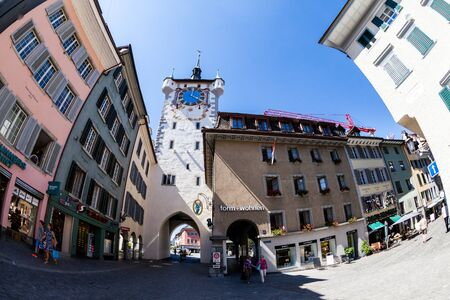 aargau: BADEN, AARGAU, SWITZERLAND - JUNE 30, 2015: Exterior views of the tower Stadtturm in Baden on June 30, 2015. Baden is a municipality in the Swiss canton of Aargau, located 25 km (16 mi) northwest of Zurich.