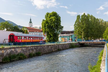 renewed: RUZOMBEROK, SLOVAKIA - JUNE 3, 2015: View to the buildings near Revuca river in the city center of Ruzomberok on June 3, 2015. Ruzomberok is a town in northern Slovakia, in the historical Liptov region.