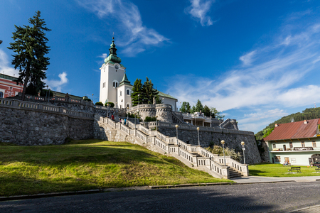 ruzomberok: RUZOMBEROK, SLOVAKIA - JUNE 3, 2015: View to the church St. Andrew, a famous and historical buildings on June 3, 2015. Ruzomberok is a town in northern Slovakia, in the historical Liptov region.