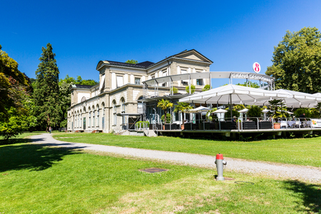 aargau: BADEN, AARGAU, SWITZERLAND - JUNE 30, 2015: View of the Kurpark and the Casino of Baden on June 30, 2015. Baden is a municipality in the Swiss canton of Aargau, located 25 km (16 mi) northwest of Zurich.