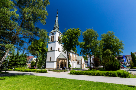 renewed: DOLNY KUBIN, SLOVAKIA - JUNE 5, 2015: Exterior view of the churches in the city centre of Dolny Kubin, Slovakia on June 5, 2015. It is the historical capital of the Orava region. Editorial
