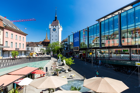 ag: BADEN, AARGAU, SWITZERLAND - JUNE 30, 2015: Exterior views of the tower Stadtturm in Baden on June 30, 2015. Baden is a municipality in the Swiss canton of Aargau, located 25 km (16 mi) northwest of Zurich.
