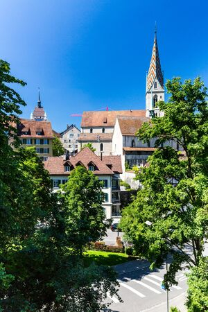 renewed: BADEN, AARGAU, SWITZERLAND - JUNE 30, 2015: Exterior views of the Church in old town part of Baden on June 30, 2015. Baden is a municipality in the Swiss canton of Aargau.