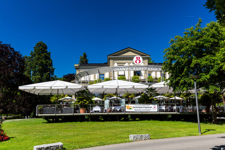 ag: BADEN, AARGAU, SWITZERLAND - JUNE 30, 2015: View of the Kurpark and the Casino of Baden on June 30, 2015. Baden is a municipality in the Swiss canton of Aargau, located 25 km (16 mi) northwest of Zurich.
