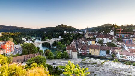 aargau: BADEN, AARGAU, SWITZERLAND - JULY 1, 2015: View from Mountain Lagern to the city of Baden and river Limmat at sunset on July 1, 2015. Baden is a municipality in the Swiss canton of Aargau. Editorial