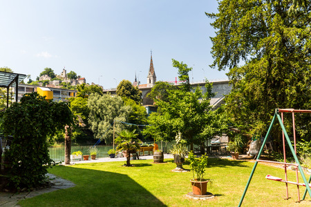 private parts: BADEN, AARGAU, SWITZERLAND - JUNE 30, 2015: Typical view from Wettingen side to the city of Baden and a playground on June 30, 2015. Baden is a municipality in the Swiss canton of Aargau.