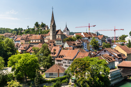 aargau: BADEN, AARGAU, SWITZERLAND - JULY 2, 2015: Exterior view from Wettingen side to the old town part of the city of Baden on June 30, 2015. Baden is a municipality in the Swiss canton of Aargau.