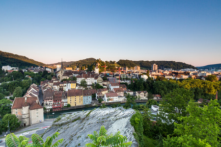 aargau: BADEN, AARGAU, SWITZERLAND - JULY 2, 2015: View from Mountain Lagern to the city of Baden and river Limmat at sunrise on July 2, 2015. Baden is a municipality in the Swiss canton of Aargau.