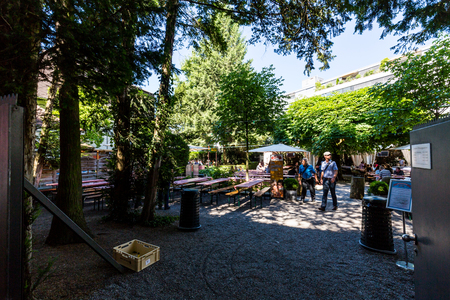 aargau: BADEN, AARGAU, SWITZERLAND - JUNE 30, 2015: View to the brewery Muller Brau and its beergarden on June 30, 2015. Baden is a municipality in the Swiss canton of Aargau. Editorial