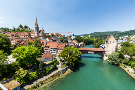 aargau: BADEN, AARGAU, SWITZERLAND - JULY 2, 2015: Exterior view from Wettingen side to the  of the city of Baden and river Limmat on June 30, 2015. Baden is a municipality in the Swiss canton of Aargau. Editorial