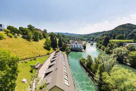aargau: BADEN, AARGAU, SWITZERLAND - JULY 2, 2015: Exterior view of  the hydroelectric power station of Baden and the river Limmat on July 2, 2015. Baden is a municipality in the Swiss canton of Aargau.