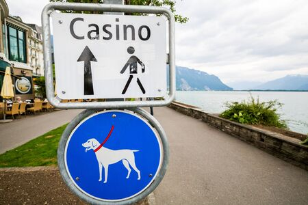 montreux: MONTREUX, SWITZERLAND - MAY 23, 2015: Casino walk sign board in Montreux, Switzerland on May 23, 2015. Montreux is located on Lake Geneva at the foot of the Alps.