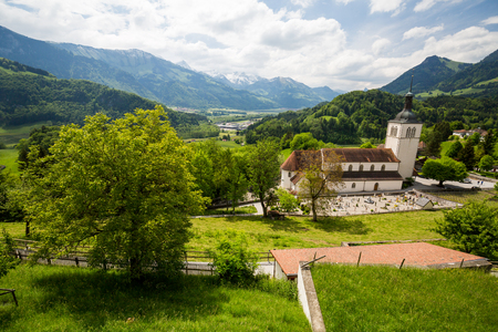 gruyere: GRUYERES, SWITZERLAND - MAY 23, 2015: View of the historical town Gruyeres in the canton of Fribourg, Switzerland on May 23, 2015. Gruyere is a famous tourist destination and also know for its cheese.