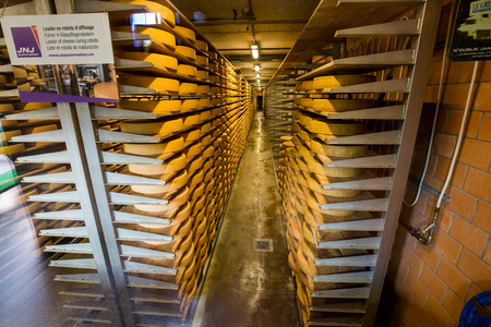 gruyere: GRUYERES, SWITZERLAND - MAY 23, 2015: Interior view of a cheese diary in the historical town Gruyeres in the canton of Fribourg, Switzerland on May 23, 2015. Gruyere is a famous swiss cheese. Editorial