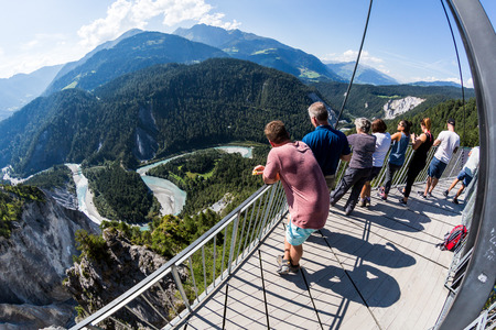 FLIMS, SWITZERLAND - SEPTEMBER 10, 2016: People on the platform Il Spir near Flims on September 9, 2016. The platform provides a beautiful overlook to the Rhine Valley in the canton Graubunden.