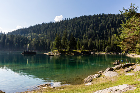 View of the Lake Cauma and tourist bathing in it. This lake is popular by tourist for swimming or relaxing.