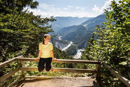 View of a Girl on the outlook viewpoint Il Spir at the Rhine Valley, Flims, Switzerland Stock Photo