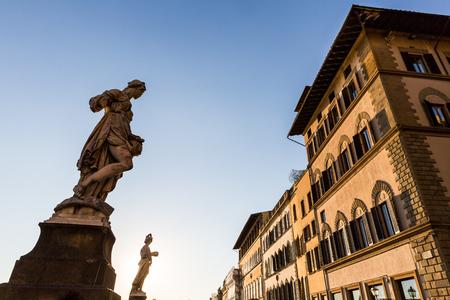 View of a statue at the Ponte Santa Trinita bridge in Florence, Italy