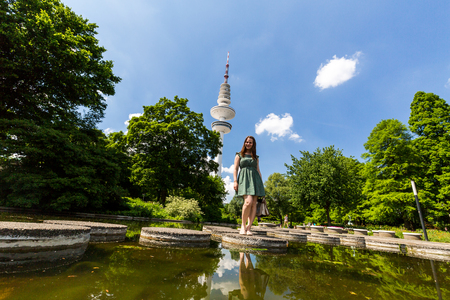 heinrich: View of a girl in the front of the Heinrich Hertz Tower in Hamburg Stock Photo