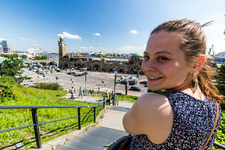 Girl in front of the St. Pauli Piers on of Hamburgs main attractions Stock Photo