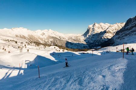 KLEINE SCHEIDEGG, SWITZERLAND - JANUARY 6, 2017: View of the ski resort Jungfrau Wengen on January 6, 2017. This resort is in the alps of canton Bern and famous for ski racing Lauberhornrennen.