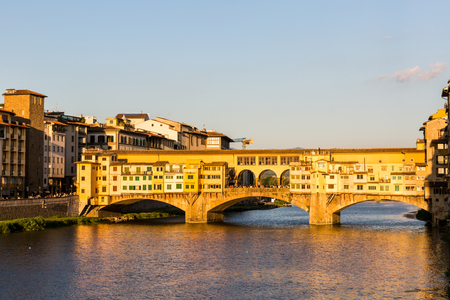 FLORENCE, ITALY - JULY 16, 2016: View of the Ponte Vecchio in Florence on July 16, 2016. Florence is the capitol city of the Tuscany region and very popular by tourist. Editorial