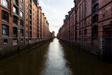 vanishing point: HAMBURG, GERMANY - JUNE 6, 2016: Typical view of the Speicherstadt, also called Hafen City,  in Hamburg on June 6, 2016. Its a popular harbour quarter for tourists in Hamburg.
