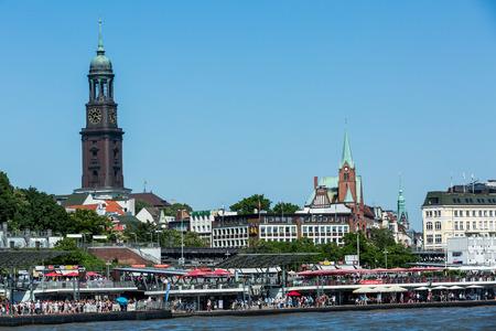 st michel: HAMBURG, GERMANY - JUNE 4, 2016: View of the St. Pauli Piers (German: St. Pauli Landungsbrucken) one of Hamburgs major tourist attractions on June 4, 2016. Its the largest landing place Hamburg. Editorial