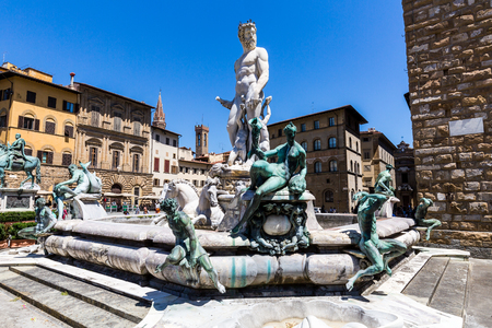 FLORENCE, ITALY - JULY 17, 2016: Buildings and the Fountain of Neptune at the Piazza della Signoria on July 17, 2016. Its an large L-shaped square in front of the Palazzo Vecchio. Editorial
