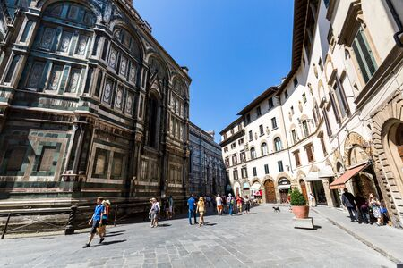 gothic revival: FLORENCE, ITALY - JULY 17, 2016: Exterior view of the Florence Cathedral on July 17, 2016. The exterior of the basilica is faced with polychrome marble panels in various shades.