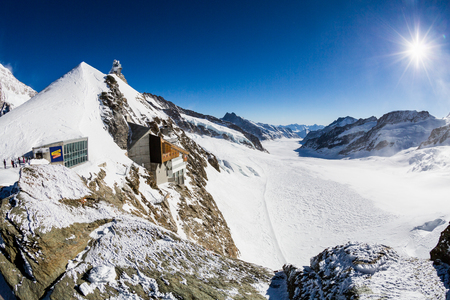 jungfraujoch: JUNGFRAUJOCH, SWITZERLAND - JANUARY 6, 2017: View to the Jungfraujoch observation station and Aletsch Glacier on January 6, 2017. Its the highest elevated point to reach by a cog railway in Europe.
