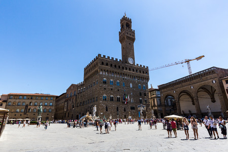 FLORENCE, ITALY - JULY 17, 2016: Exterior view of the Palazzo Vecchio at the Piazza della Signoria in Florence on July 17, 2016. It was originally called the Palazzo della Signoria.
