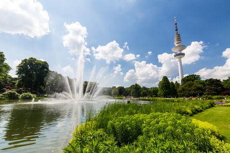 HAMBURG, GERMANY - JUNE 5, 2016: View of the Planten un Blomen Park near the Parksee on June 5, 2016. The nature park in middle of Hamburg is popular for tourist and locals for sporting or relaxing.