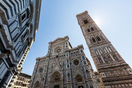 polychrome: FLORENCE, ITALY - JULY 17, 2016: Exterior view of the Florence Cathedral on July 17, 2016. The exterior of the basilica is faced with polychrome marble panels in various shades.