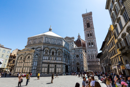 polychrome: FLORENCE, ITALY - JULY 17, 2016: Exterior view of the Florence Baptistery on July 17, 2016. The exterior of the basilica is faced with polychrome marble panels in various shades.