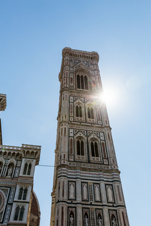 FLORENCE, ITALY - JULY 17, 2016: Exterior view of the Florence Cathedral on July 17, 2016. The exterior of the basilica is faced with polychrome marble panels in various shades.