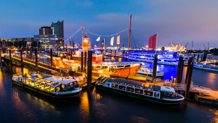 st pauli: HAMBURG, GERMANY - JUNE 8, 2016: View of the St. Pauli Piers (German: St. Pauli Landungsbrucken) one of Hamburgs major tourist attractions on June 8, 2016. Its the largest landing place Hamburg. Editorial