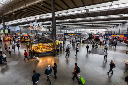 MUNICH, GERMANY - JUNE 22, 2016: Interior view of the Munich main railway station (Munchen Hauptbahnhof) on June 22, 2016. It is one of the three long distance stations in Munich. Editöryel