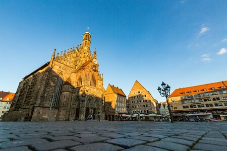 bayern old town: NURENBERG, GERMANY - JUNE 22, 2016: Exterior view of the Frauenkirche and historical building around in the old town part of Nurnberg on June 22, 2016. Its on the eastern side of the main market