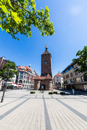 NUREMBERG, GERMANY - JUNE 23, 2016: View of the White Tower (Weisser Turm) in the old town part of Nuremberg on June 23, 2016. Nuremberg is the second-largest city in Bavaria.
