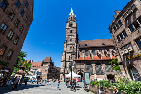 NUREMBERG, GERMANY - JUNE 23, 2016: View of St. Lorenz Church in the old town part of Nuremberg on June 23, 2016. It is the second-largest city in Bavaria, and the largest in Franconia.