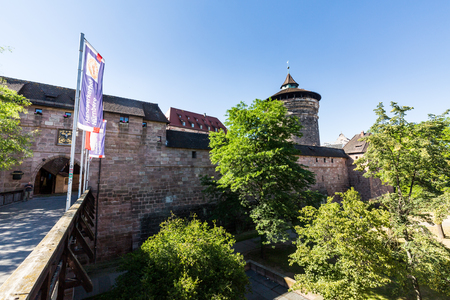 NUREMBERG, GERMANY - JUNE 23, 2016: View of Frauentorturm in the old town part of Nuremberg on June 23, 2016. It is the second-largest city in Bavaria, and the largest in Franconia. Editorial