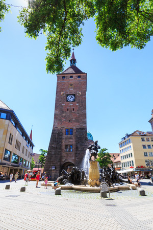 exaggerated: NUREMBERG, GERMANY - JUNE 23, 2016: View of the White Tower (Weisser Turm) in the old town part of Nuremberg on June 23, 2016. Nuremberg is the second-largest city in Bavaria.