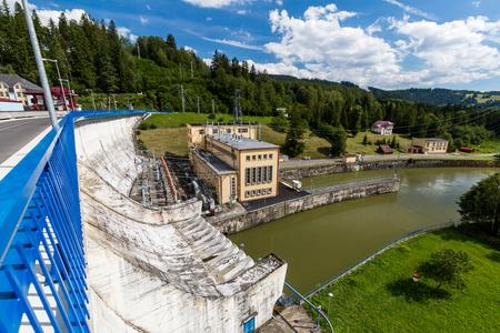 USTIE NAD PRIEHRADOU, SLOVAKIA - AUGUST 2, 2016: View of the hydroelectric power plant Oravska Priehrada in Slovakia on August 2, 2016. Its the biggest Slovakian lake in the northern region Orava.